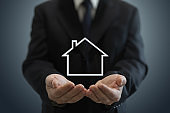 House real estate insurance investment protection safe businessman hands holding