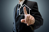 House real estate insurance investment protection safe businessman hand touching