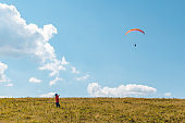 mountains leisure activities. paragliding. summer time