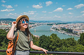 smiling cheerful woman in sunglasses. budapest city on background