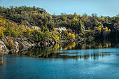 Old abandoned quarry. Autumn in New England, USA