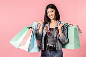 Tourist woman in summer casual clothes.Asian Smiling woman .Passenger traveling and shopping on pink background.She going to summer vacation.Travel trip funny  on holiday.