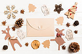 Top view of envelope on festive wooden background. Christmas toys and decorations. New Year time concept