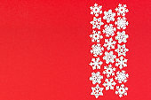 Top view of winter ornament made of white snowflakes on colorful background. Happy New Year concept with copy space