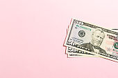 Top view of bundle of 50 dollar bill on colorful backgound. Business concept with copy space