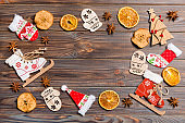Top view of Christmas decorations and toys on wooden background. Copy space. Empty place for your design. New Year concept