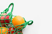 Zero waste. Green shopping textile bag with fresh orange and vegetables. Space for text.