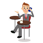 Office worker making a mobile phone call at a coffee shop