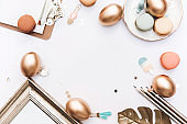 Happy Easter! Stylish stationery background with gold eggs on white background. Minimal concept.Table decorating for holiday. Feminine flat lay. Blog easter concept.