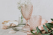 Pink Vintage Wedding Table Setting -crystal wine glasses with flowers, minimal lifestyle concept