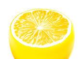 Slice of lemon isolated on white background.