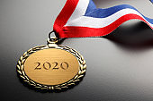 Gold Medal Engraved With 2020 On Black Background
