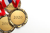 Three Stacked Gold Medals Engraved 2020, 2019, And 2018