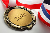 Gold Medal Engraved With 2020 On White Background
