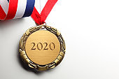 Gold Medal On Ribbon Inscribed With 2020 Engraved On White Background