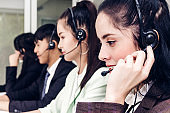 Beautiful businesswoman customer support services working with headset and computer at call center