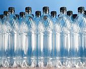 empty plastic bottles on blue background