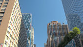 LOW ANGLE VIEW: Tall skyscrapers, office corporate buildings in downtown of NYC