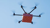 CLOSEUP LENS FLARE Last minute gift delivery by cargo multirotor. Drone delivery