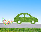 green eco friendly car concept made of grass and flowers 3D illustration
