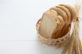 Fresh homemade  baked whole grain bread and sliced bread on wooden