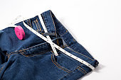 Jeans with measure tape. Diet concept.