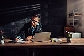 Businessman writing project report in his office