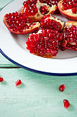 pomegranate seeds on wooden surface