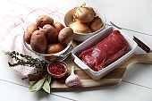 Raw beef, potatoes, onions, garlic, bay leaf, pink pepper and thyme