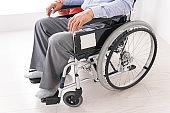 Women care for elderly person