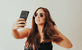 hipster teen girl with sunglasses sunny sunday monday taking selfie in studio berlin munich stock photo to go out night out germany EU UK united kingdom serbia beauty camera phone mobile nature hairstyle black white love smile