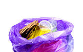 Concept of garbage and pollution. A pile of trash, crumpled plastic cup, packages, paper isolate on a white background