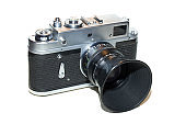 retro rangefinder film camera with big lens hood, front angled view