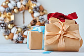 Christmas gift box with ribbon and christmas decorations on a white background, close up