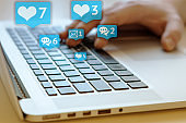 Person is using laptop with black keys, Social media and social networking. Marketing concept. Hearts and letterboxes with counters. Marketing and business concept. May be used for illustration.
