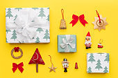 Wrapped christmas gifts and many retro christmas ornaments isolated on bright yellow background. Christmas composition.