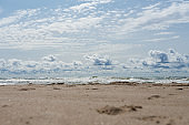 Beautiful view of wavy sea on a sunny day with dramatic clouds.