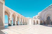 Inner courtyard of the Hassan II Mosque in Casablanca. Entrance doors on the right.