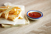 Close up French Fries with a tomato sauce on the table , fatty unhealthy  junk food concept