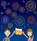 Two people toasting with beer in the fireworks