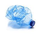 Crushed plastic bottle isolated on white background