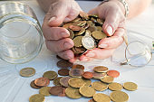 hand of pensioner with coins and savings in the hands