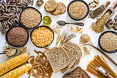 Dietary fiber: large group of wholegrain food shot from above on white background