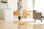 Housewife cleaning with vacuum cleaner