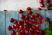 Fresh cherries on wood