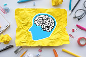 Inspiration creativity concepts with brain drawing on paper crumpled on worktable