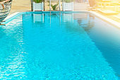 blurred summer vacation background    turquoise water of the  swimming pool