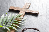 Easter wooden cross on black marble background religion abstract palm sunday concept