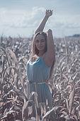 beautiful woman in silver dress on a field