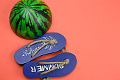 decorative wooden flip flops and squishy toy watermelon